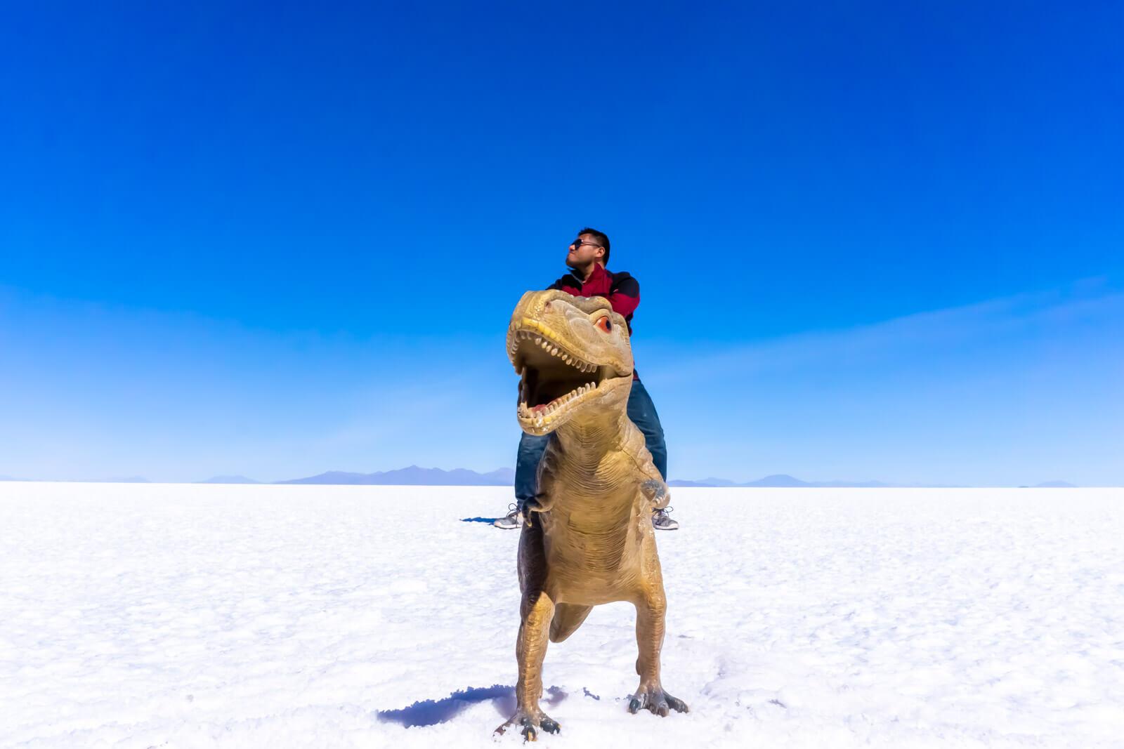The Man of Wonders riding a T-Rex at the Salar de Uyuni