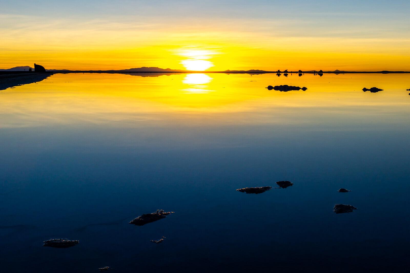 The sunrise reflections at the Salar de Uyuni in Bolivia