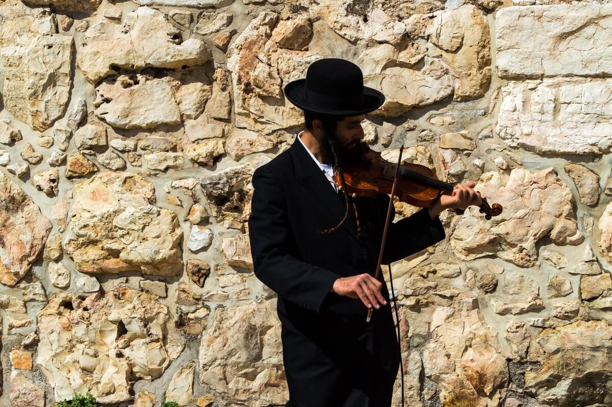 Orthodox Jew playing the violin