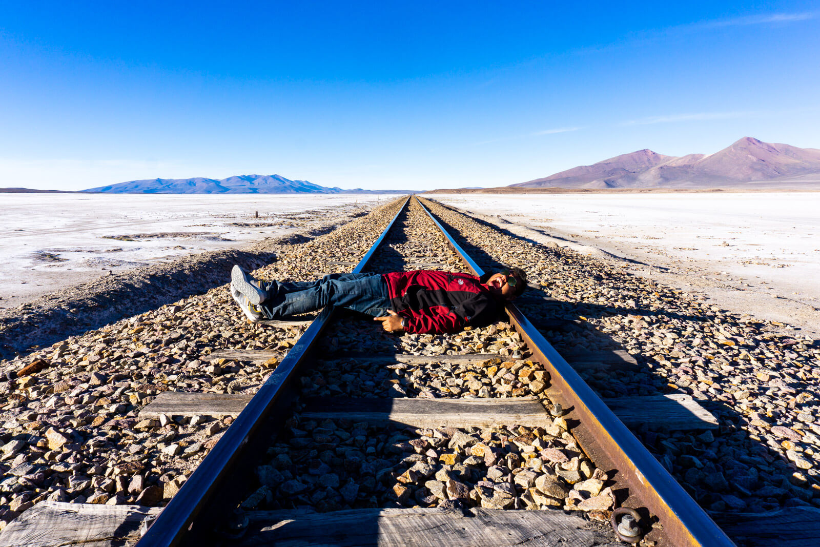 The Man of Wonders about to be killed at the train tracks of the Salar de Uyuni